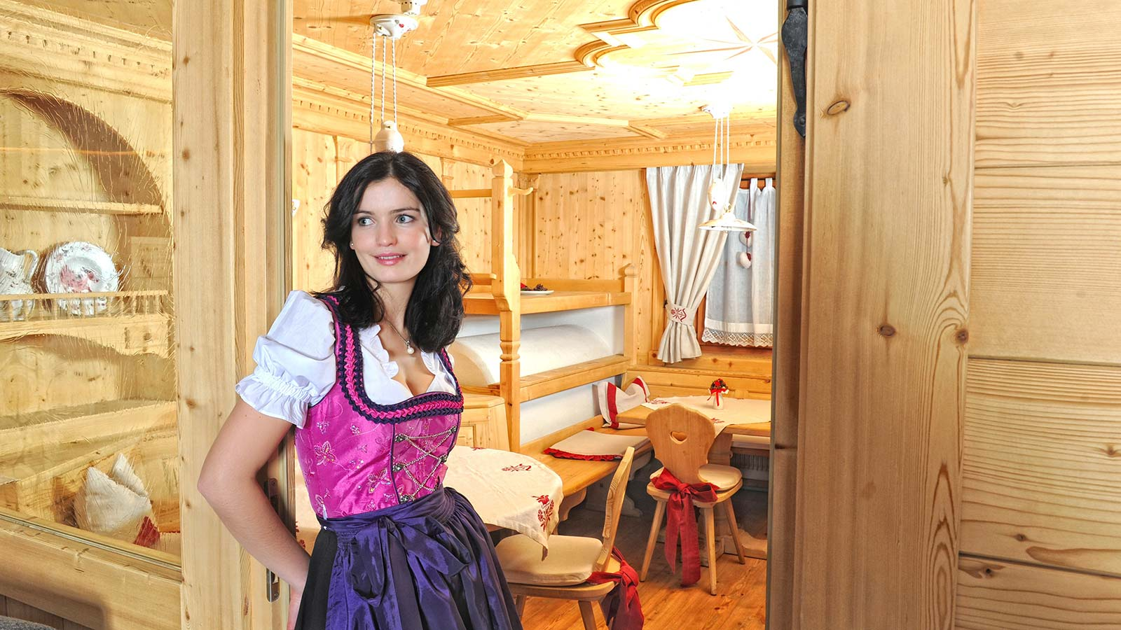 Girl with dirndl, traditional tyrolean dress, inside Hotel Teresa's stube