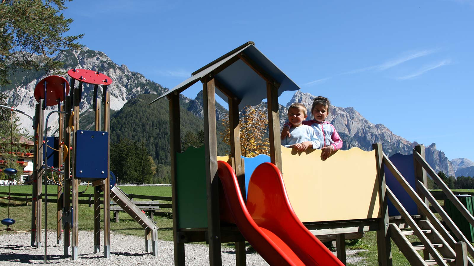 Kids on a slide in the playground