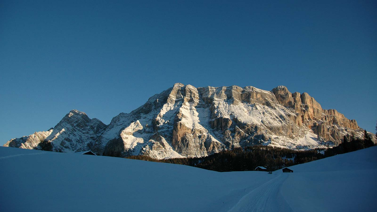 The snow dolomitic landscape of Monte Cavallo with Santa Croce at twilight